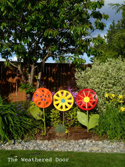 Colorful Upcycled Hubcap Flowers