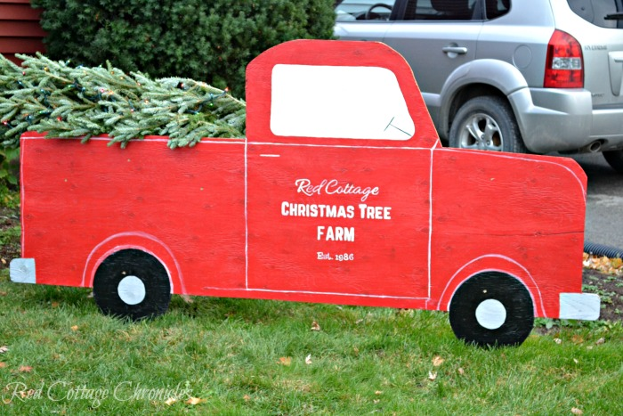 Large Red Christmas Truck With a Tree